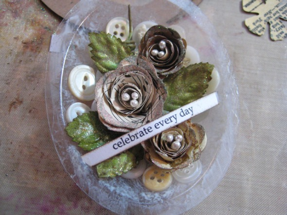 DIY Ornament: back globe with vintage buttons and 3D paper flowers.