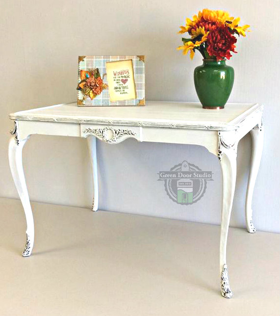 white ornate table for site
